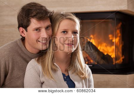 Young Couple By Fireplace