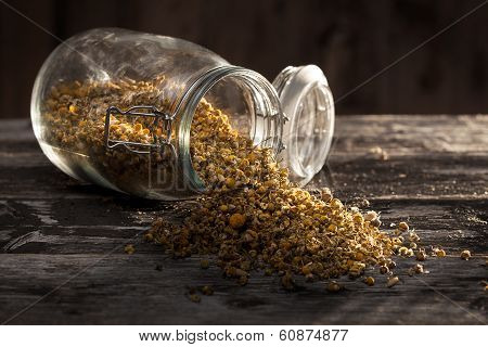 Dried Chamomile Flowers On A Wood Table