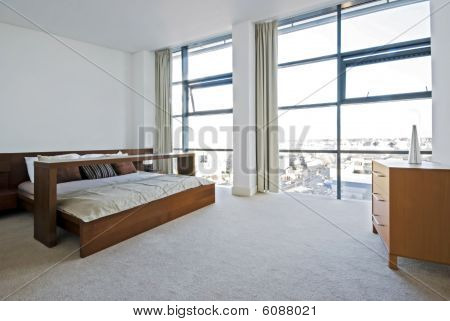 Luxury Bedroom With Floor To Ceiling Windows
