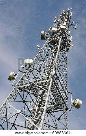Telecommunication tower with antennas over blue sky poster