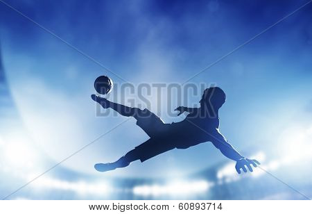 Football, soccer match. A player shooting on goal performing a bicycle kick. Lights on the stadium at night.