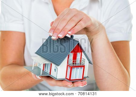 a broker for real estate with a house and a key. successful leasing and home sales by real estate agents.