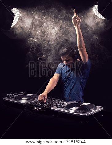 Deejay Mixing At Party