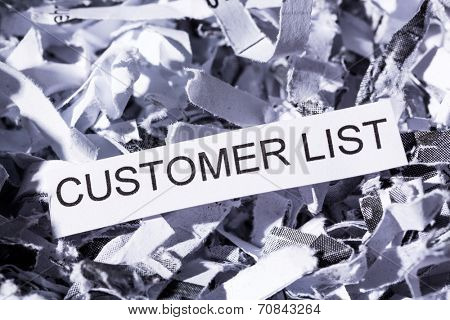 shredded paper tagged with customer list, symbol photo for data destruction, data protection and customer data