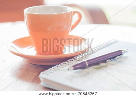 Pen And Spiral Notebook With Coffee Cup