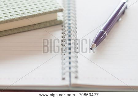 Pen And Green Notebook On Spiral Notebook