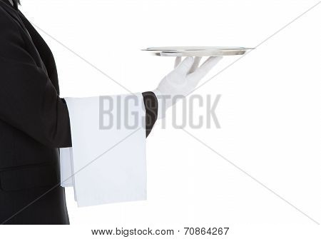 Cropped Image Of Waiter Holding Empty Tray