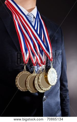 Businessman Wearing Gold Medals