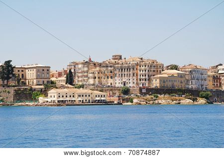 CORFU, GREECE - JUNE 23, 2014: Looking towards the buildings of Corfu Town from Kerkira harbour on the Greek island of Corfu. At 40 miles long, Corfu is the second largest of the Ionian islands.