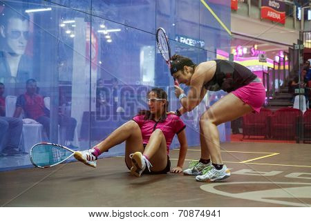 AUGUST 21, 2014 - KUALA LUMPUR, MALAYSIA: Habiba Ahmed of Egypt falls while playing Amanda Sobhy of USA in a match at the CIMB Malaysian Open Squash Championship 2014 held in Nu Sentral Mall.