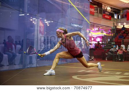 AUGUST 21, 2014 - KUALA LUMPUR, MALAYSIA: Madeline Perry of Ireland (pink shirt) hits a return in a match during the CIMB Malaysian Open Squash Championship 2014 held in Nu Sentral Mall.
