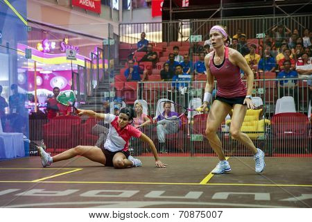 AUGUST 21, 2014 - KUALA LUMPUR, MALAYSIA: Nour El Tayeb of Egypt falls while playing Madeline Perry of Ireland in the CIMB Malaysian Open Squash Championship 2014 match held in Nu Sentral Mall.