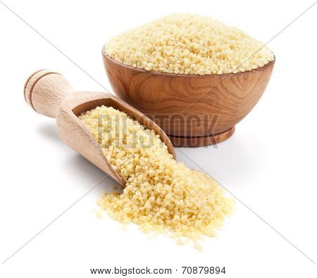 Cuscus In A Wooden Bowl Isolated On White