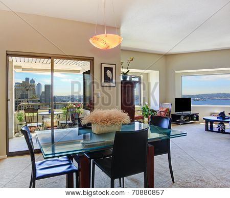 Modern Apartment Interior. View Of Glass Top Dining Table With Chairs