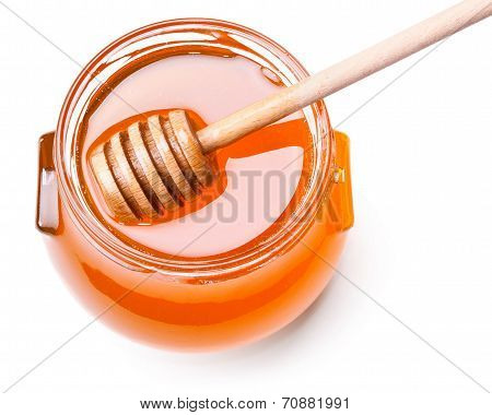 Glass Jar Of Honey With Wooden Drizzler Isolated On White