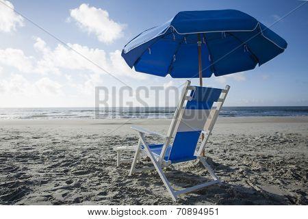 Beach Chair and Umbrella at the Ocean