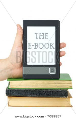 Hand Put E-book Reader On Top Of Classic Paper Books