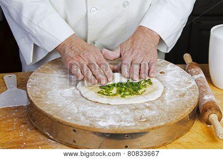 Rolling chopped scallions