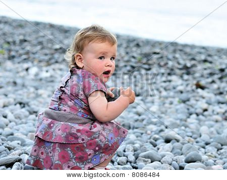 Baby With Pebble
