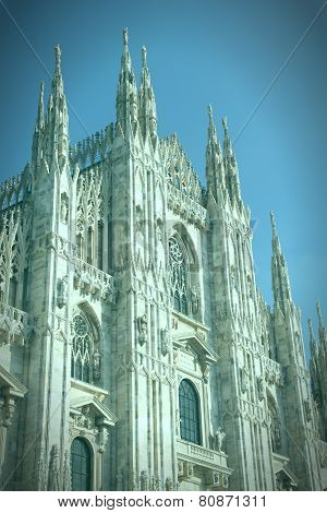 Milan Italy, famous landmark, the cathedral made of Candoglia marble. Cross processed color tone - retro image filtered style. poster