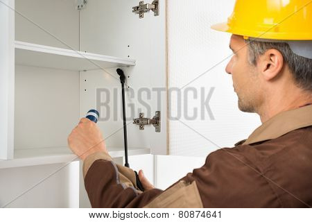 Pest Control Worker Wearing Hardhat Spraying Pesticides