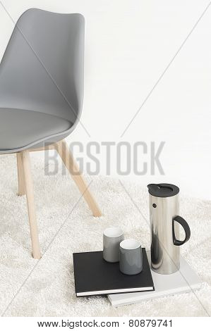 Serving Of Coffee Alongside A Modern Chair