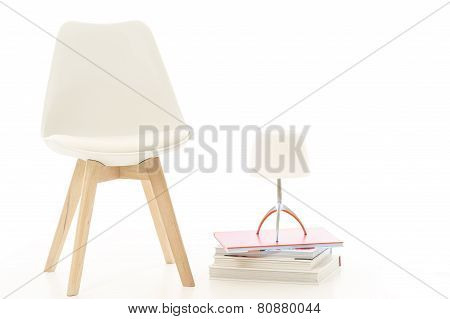 Modern White Chair And Lamp In Studio