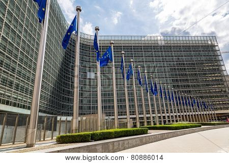European flags in front of headquarters of European commission in Brussels in summer day poster