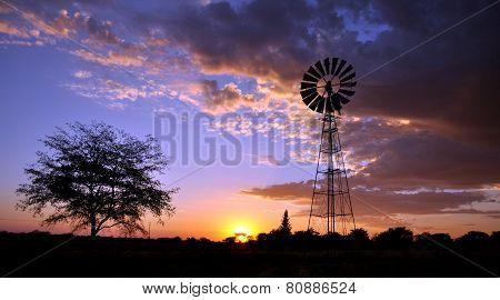 Windmill In Desert Sunset