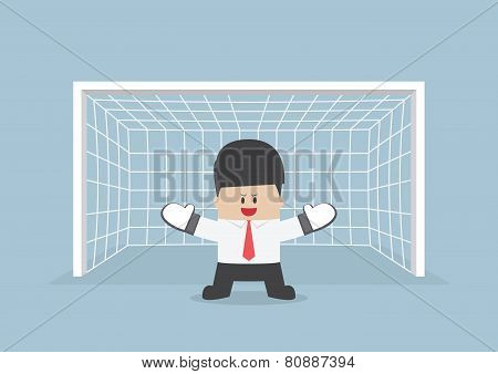 Businessman Playing Goalkeeper Standing In Front Of Goal Ready To Block The Ball