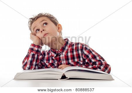 Fantasizing Boy With Book