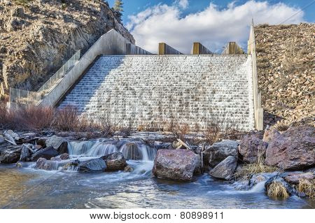 spillway of Seam an Reservoir (North Fork of Cache la Poudre RIver) in Rocky Mountains near Fort Collins, Colorado