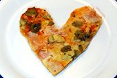 heart-shaped pizza with tomato mushrooms and ham poster