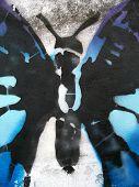 stencil grafitti sprayed on a wall street art butterfly wings poster
