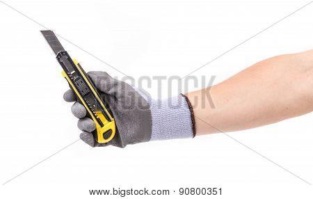 Hand in gloves holding knife.