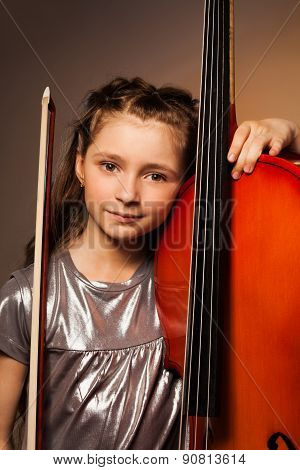 Girl with violoncello and string on gel background