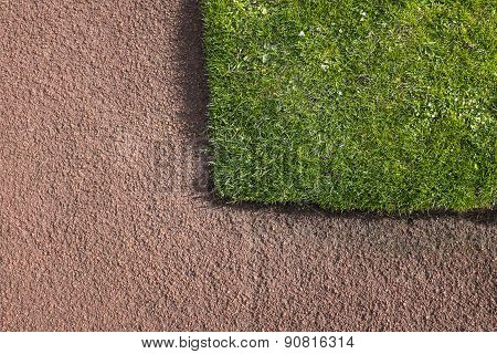 Corner Of Green Lawn Adjacent To Red Tarmacadam Path - Construction Detail