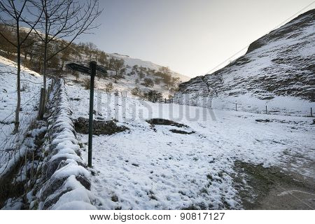 Snow Covered Winter Landscape In Forest Valley