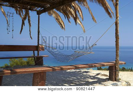 hammock Swing on a tropical beach - vacation background