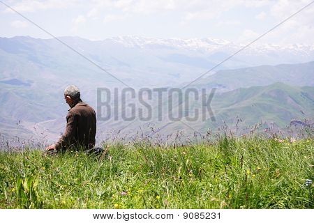 Praying Man Kneeling Rear View