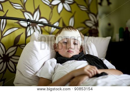 Sick boy lying in bed