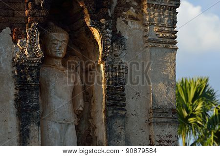 sculpture buddha stone statue in temple buddhism Wat Cham Thewi Lamphun Thailand poster