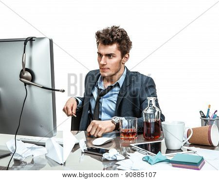 Businessman Sitting In His Office As He Reads Information Or Looks At A Presentation On His Computer
