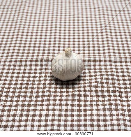 fresh garlic on a kitchen towel background