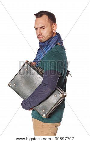Sullen sad man with suitcase