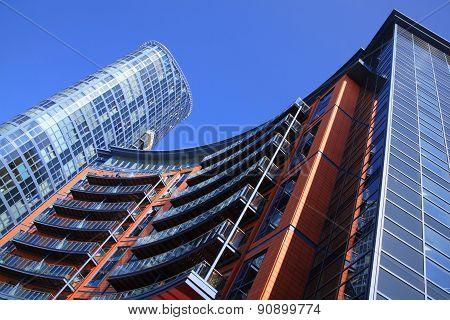 Futuristic apartment flats and office skyscraper