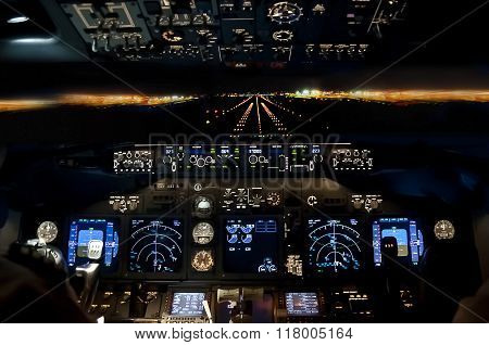 Final Approach At Night - Landing Plane Flight Deck View