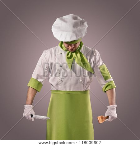 chef with knife and kitchen spatula