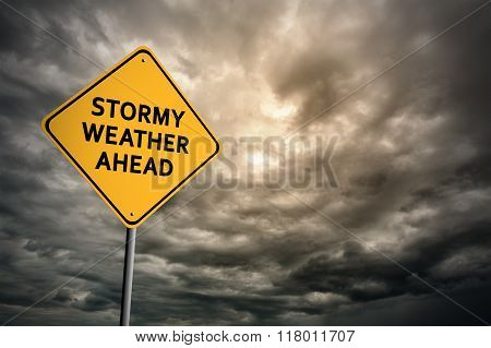 Sign with words 'Stormy weather ahead' on a background of thunderclouds