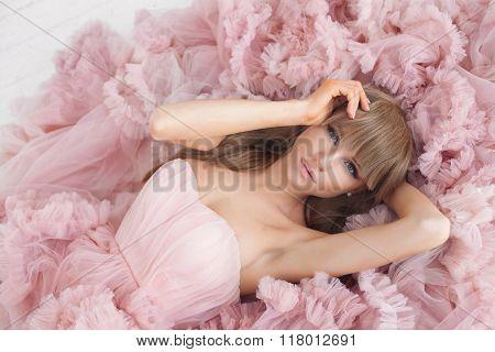Portrait of a fashion woman in gorgeous long pink dress